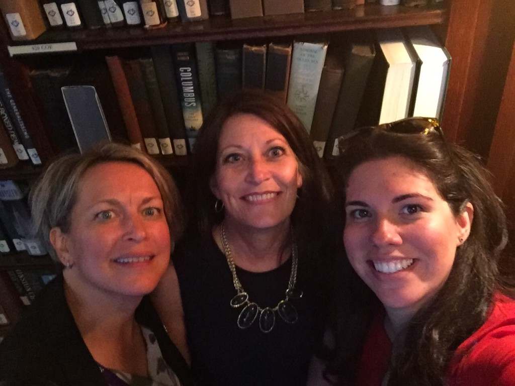 "Chris Sebelski, Lisa Dorsey, and Jessica Schwartz touring the University Club library. A prime example: ""Well behaved women rarely make history."""